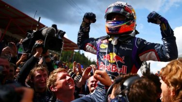 Bully for him: Daniel Ricciardo celebrates after winning the Belgian Grand Prix in August.
