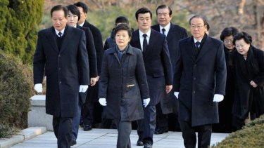 Paying respects: South Korea's conservative President Park Geun-hye (centre) visits the grave of her father, Park Chung-hee, the country's former military ruler at the National Cemetery in Seoul on December 20, 2012.