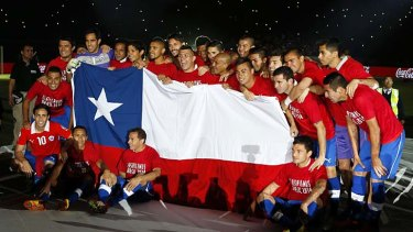 Chilean players celebrate after defeating Ecuador.