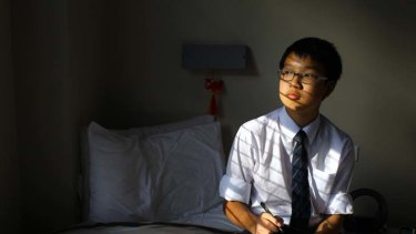 Ink to the past ... Knox Grammar School student Alex Li regularly writes letters to his family in Hong Kong instead of using Skype or texting.
