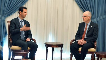 Syrian President Bashar al-Assad meets with Australian academic Tim Anderson in Damascus, in a photo released by Syrian news agency SANA.