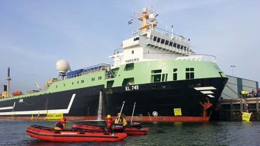The supertrawler Margiris is locked down by Greenpeace activists in the Dutch port of Ijmuiden today.