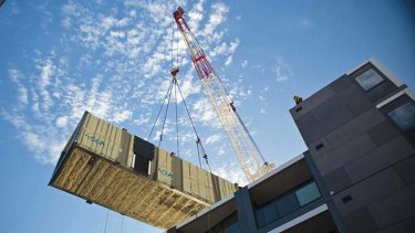 Construction: The housing boxes would be assembled by crane at half the price of traditional building.