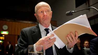 Reserve Bank governor Glenn Stevens appears before the economics committee at Parliament House .