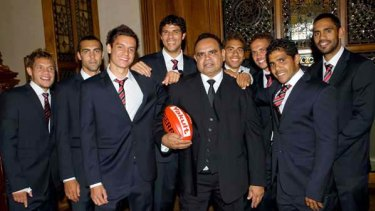 Essendon's midfield magician Michael Long is flanked by current indigenous Bombers (from left) Leroy Jetta, Courtenay Dempsey, Anthony Long, Paddy Ryder, Jarrod Atkinson, Mark Williams, Alwyn Davey and Nathan Lovett-Murray at the club's Hall of Fame last night.