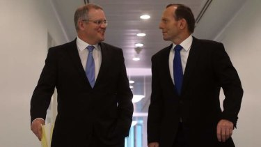 Immigration Minister Scott Morrison, pictured with Prime Minister Tony Abbott, says it's cheaper to offer voluntary return packages than to keep asylum seekers in detention centres or on bridging visas.
