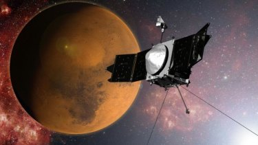 An artist's concept provided by NASA of the MAVEN spacecraft as it approaches Mars.