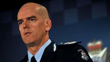 Simon Overland as Victoria Police chief commissioner.