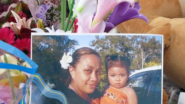 A photo of Anamalia Taufa and her three year old Kahlani Matauina left at the makeshift shrine outside the Slacks Creek home.