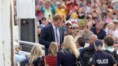 Prince Harry greets the crowd at Campbell's Cove, Sydney, during his 2013 visit.