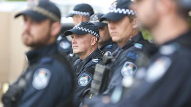 Police monitor the  protest at Senator Coy Bernardi's speech at the Broncos Leagues Club.