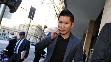 Xing Jin leaves Melbourne Magistrates Court on Wednesday after being granted bail.