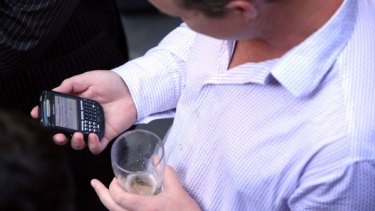 Checking emails while at the pub with friends is a habit of many BlackBerry users.