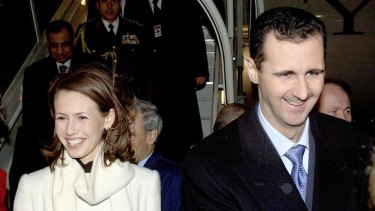 President Bashar Assad of Syria and his wife Asma arrive at London's Heathrow Airport in 2002.
