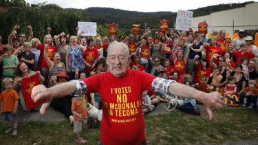 Get the message? Protesters spearheaded by the oldest Tecoma resident, 84-year-old Robert Maxwell, take a stand against McDonald's.