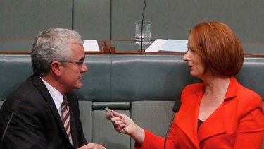 Courtship ... Prime Minister Julia Gillard talks with Independent MP Andrew Wilkie.