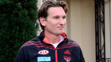 James Hird leaves his Toorak home this morning. The Bombers have dismissed Dean Robinson's claims about the coach's conduct as 'outrageous'.