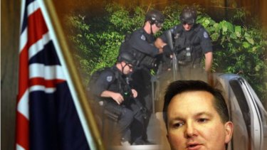 Another riot ... The Immigration Minister Chris Bowen, and (inset), police at Christmas Island in March, 2011.
