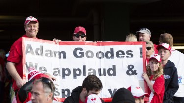 Fans around the ground held banners to show support for Goodes.
