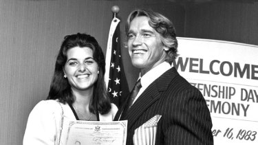 Long-term relationship ... Arnold Schwarzenegger poses with his then-girlfriend Maria Shriver while accepting his US citizenship on September 16, 1983.