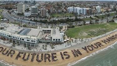 In a well-planned and choreographed protest, thousands of people turn out at St Kilda beach to say their piece.