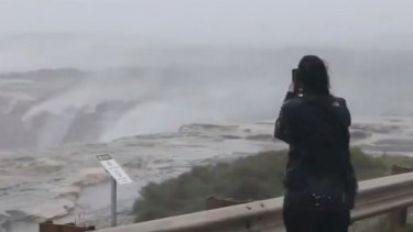 A weather system building strength off the coast of New South Wales has residents in coastal communities bracing for the worst..