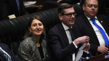 Gladys Berejiklian flanks Treasurer Dominic Perrottet as he delivers his first NSW budget.