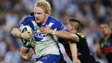 Man of steel: James Graham takes on the Penrith defence in Saturday's preliminary final.