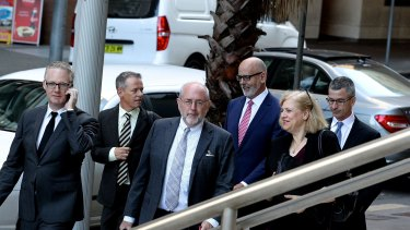 Sean Nicholls, Mark Kenny, Richard Coleman, Andrew Holden and Darren Goodsir from Fairfax Media arrive at court today. They are joined by Fairfax solicitor Leanne Norman.