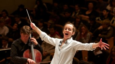 Jessica Cottis, assistant conductor at the Sydney Symphony Orchestra, conducts a concert in 2012.