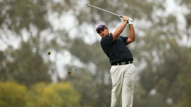 Brody Ninyette of Australia plays his approach shot on the 18th hole during day three of the Perth International at Lake Karrinyup Country Club on October 19, 2013 in Perth, Australia.  (Photo by Matt King/Getty Images)