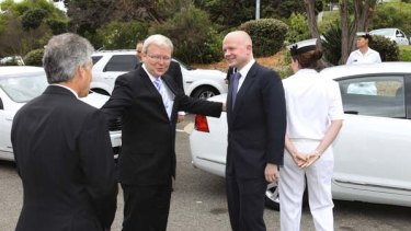 A micro moment ... Kevin Rudd introduces William Hague, right, and Stephen Smith.