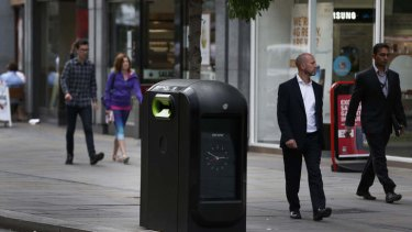 Officials say that an advertising firm must immediately stop using its network of high-tech rubbish bins, like this one, to track people walking through London's financial district.
