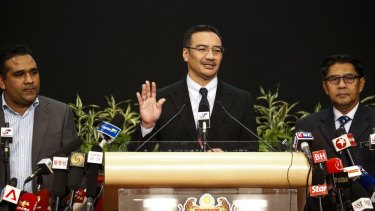 Malaysia's acting transport minister Hishammuddin Hussein giving an explanation in March last year.