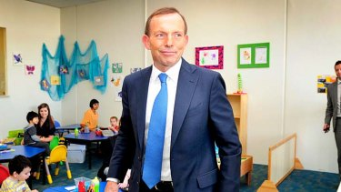 Firing line: Tony Abbott at an autism centre on Tuesday.