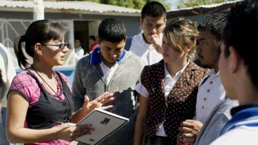 Marisol Valles speaks with high school students.