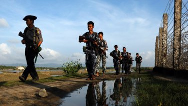 Myanmar police officers patrol  the border between Myanmar and Bangladesh in October. An attack on police at the border in October sparked the latest surge of violence.