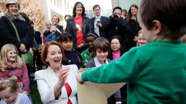 Energised: Julia Gillard meets mothers and children at Parliament House yesterday.
