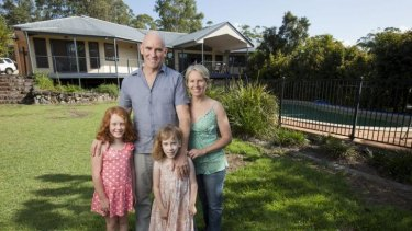 Interstate commuter Belinda Kerr at home on Queensland's Sunshine Coast with husband Michael Trehy and daughters Molly, left, and Ivy.