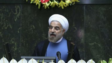 Iran's new President Hasan Rouhani delivers a speech after his swearing-in at the parliament in Tehran.