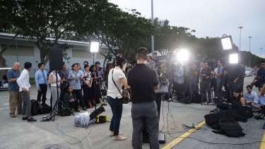 Members of the press wait for a press conference with Commander of the US Pacific Fleet Scott Swift at Singapore's Changi naval base.