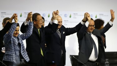 United Nations climate change chief Christiana Figueres, left, UN Secretary-General Ban Ki-moon, French Foreign Affairs Minister and UN Climate Change Conference in Paris president Laurent Fabius and French President Franois Hollande celebrate an agreement on climate change.