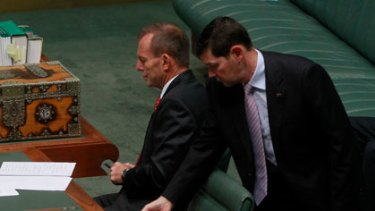 Ouch ... Tony Abbott and Kevin Andrew review press clippings.