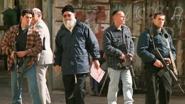 Rabbi Moshe Levinger (centre) is escorted by bodyguards in central Hebron during a protest against the   first Palestinian Authority elections in 1996.