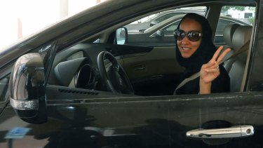 Saudi activist Manal Al Sharif, who now lives in Dubai, flashes the sign for victory as she drives her car in solidarity with Saudi women preparing to take to the wheel on Saturday.