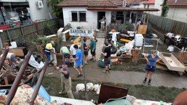 Operation Helping Hand ... this was the view yesterday from the roof of a Brisbane City Council tip truck of 139 Baroona Road where volunteers were helping restore order.