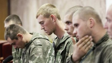 A group of Russian servicemen, who are detained by Ukrainian authorities, attend a news conference in Kiev.