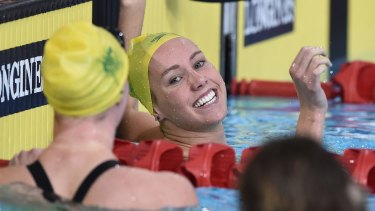 Golden night: Emma McKeon celebrates the first of two gold medals.