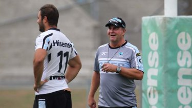 Reluctant head coach: Peter Sharp puts Wade Graham (left) and his Cronulla teammates through some drills on Thursday.