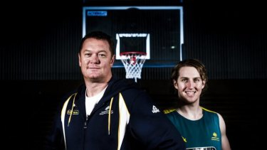 Boomers player Cameron Bairstow (right) has signed with the Chicago Bulls, where Australian assistant coach Luc Longley (left) won three NBA titles.